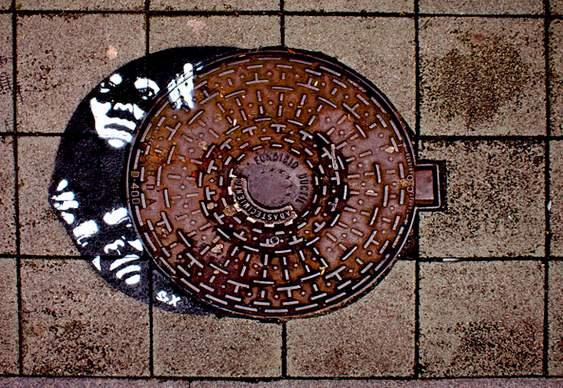 Graffiti série Escapadas pelo Bueiro