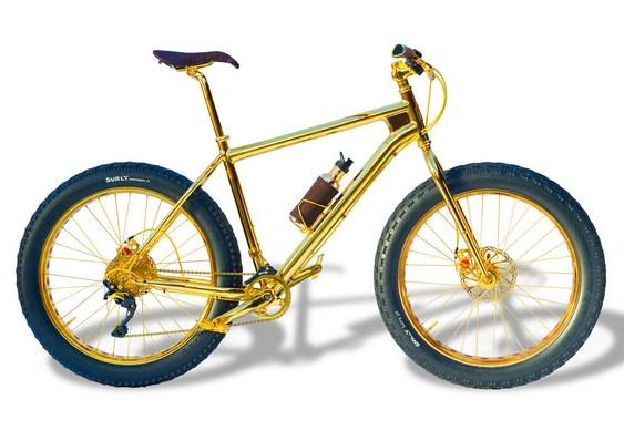 Bicicleta folheada a ouro