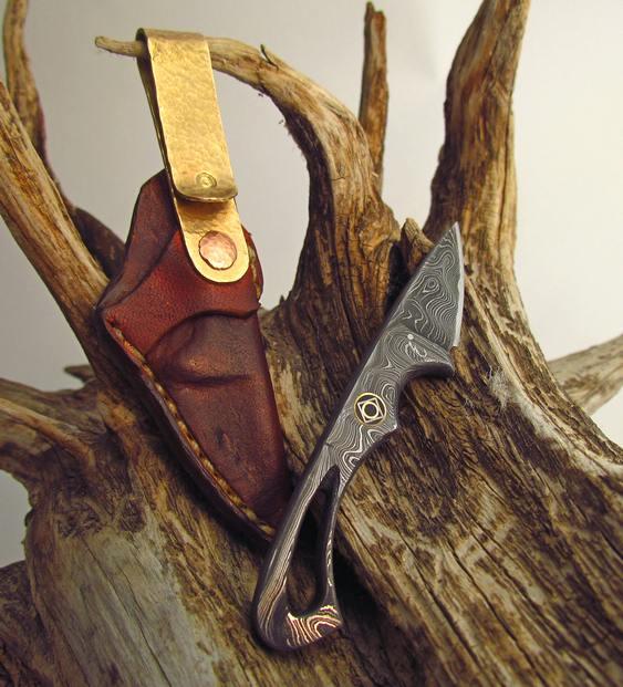 Canivete com aço de Damasco