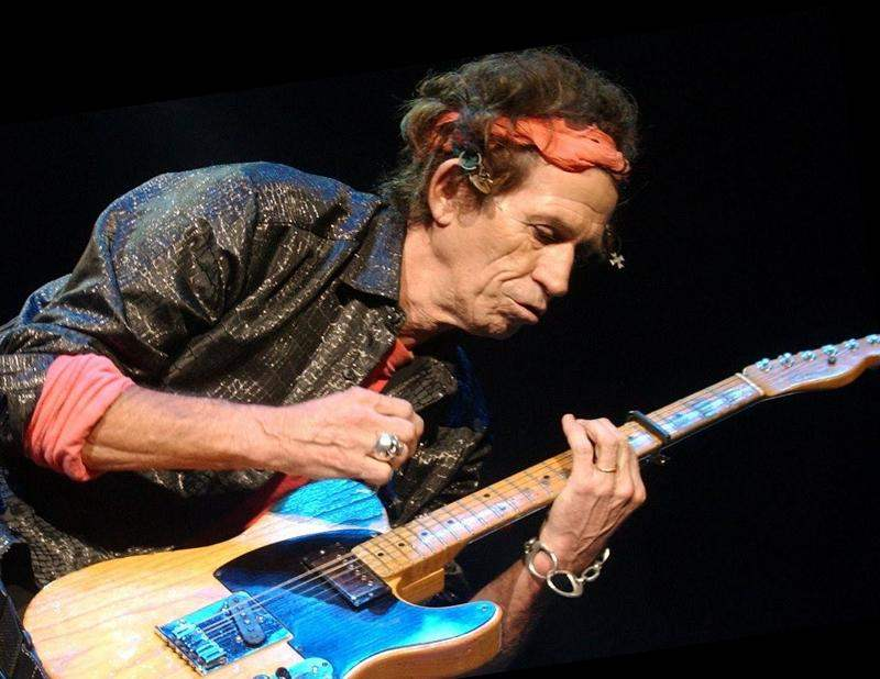 Keith Richards playing guitar