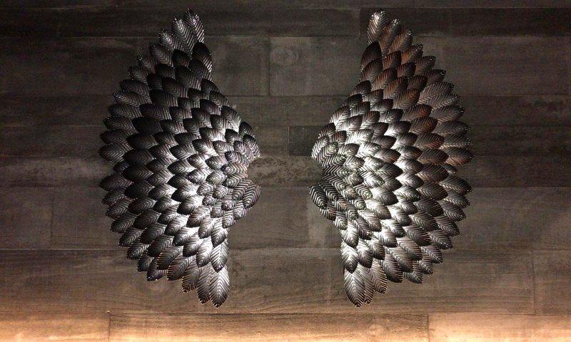 Painel com asas de anjo