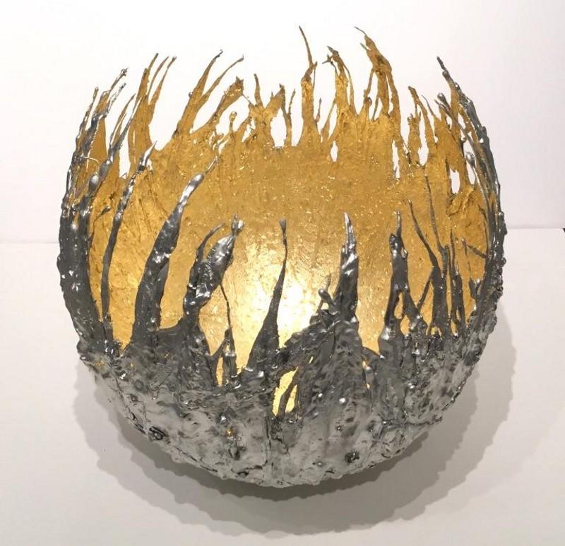 Metal prateado e dourado